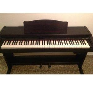 đàn piano điên roladn 1900g